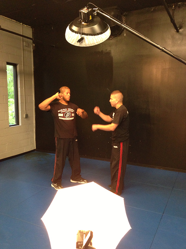 Eric Sepeda(R) goes over the knife defense move with Bryan Forman(L). This was shot with my iPhone to show the setup for the ATL Krav Maga shoot.